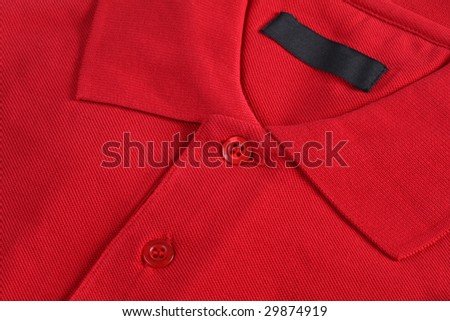 Red polo shirt close up - stock photo