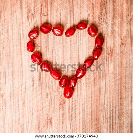 Red pomegranate fruit. Ripe vegetarian food. Sweet juicy fresh organic seed wood background. Healthy raw closeup tropical half piece with juice. Tasty antioxidant dessert. Vintage effect - stock photo