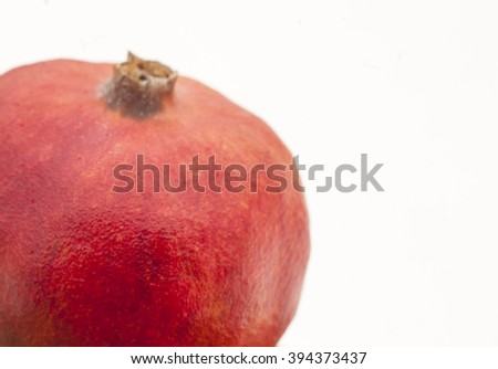 red pomegranate on a white background