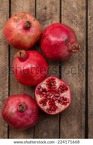 Red Pomegranates On The Wooden Background - stock photo