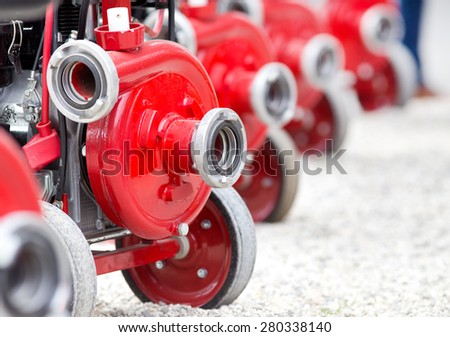 Red portable water supply system for field - stock photo