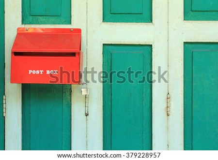 Red Post Box hanging of Door's house