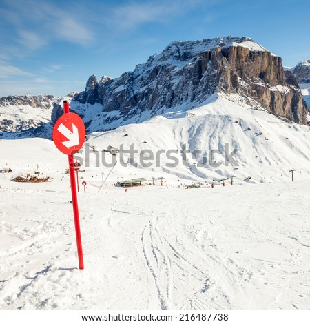 Red post sign marking the edge of ski slope - stock photo