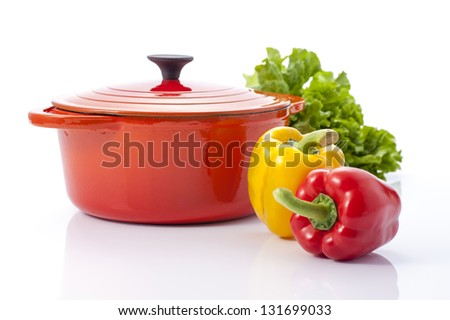 Red pot and paprika isolated on white background