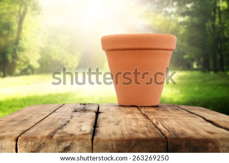 red pot on table  - stock photo