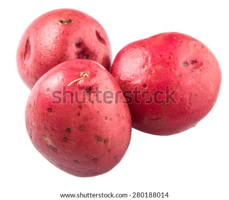 Red potato over white background - stock photo