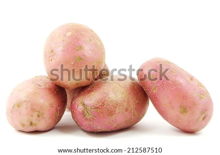 Red potatoes shot from close on a white background - stock photo