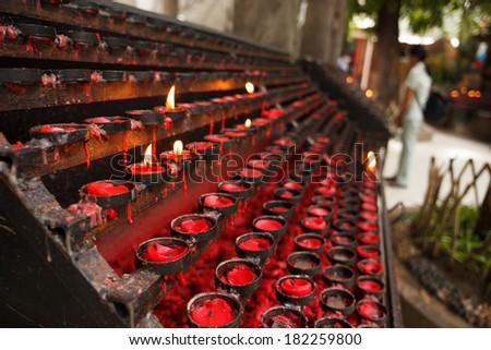 Red praying candles - stock photo