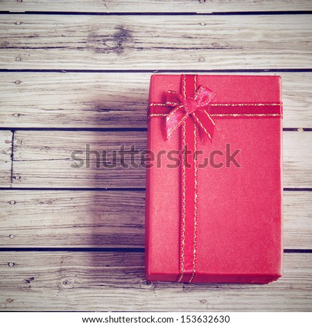 Red present box with retro filter effect - stock photo