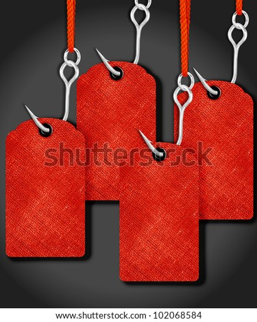 Red price tags with fishing hook. - stock photo