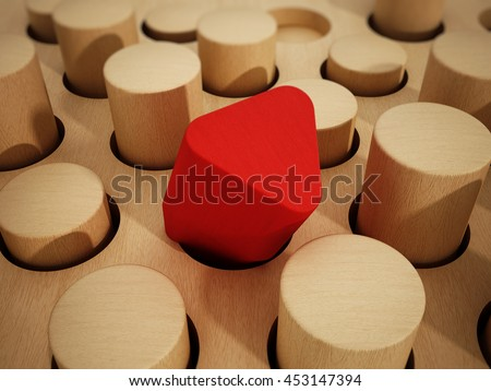 Red prism wooden block standing out among wooden cylinders. 3D illustration. - stock photo