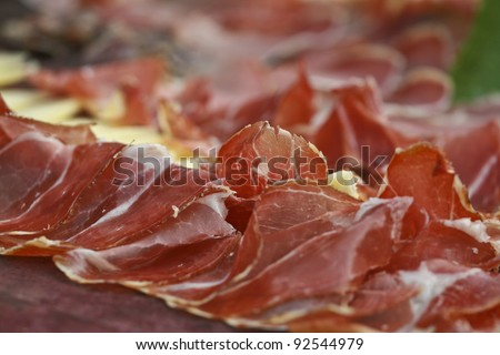 Red prosciutto and cheese - stock photo