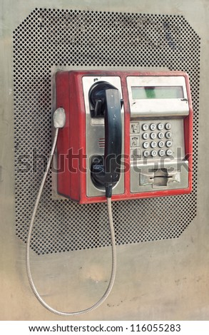 Red public phone in retro style