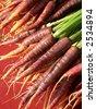 Red, purple and orange carrots - stock photo