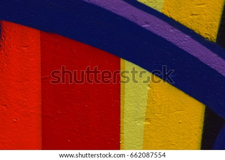 Red, Purple, and Yellow Spray Paint on Concrete