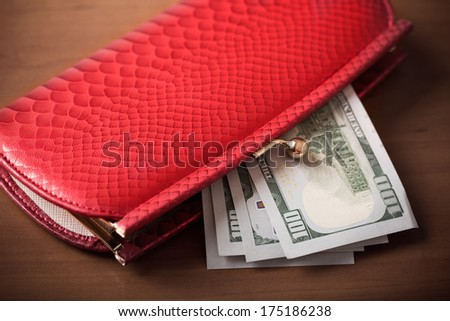 Red purse and money - stock photo
