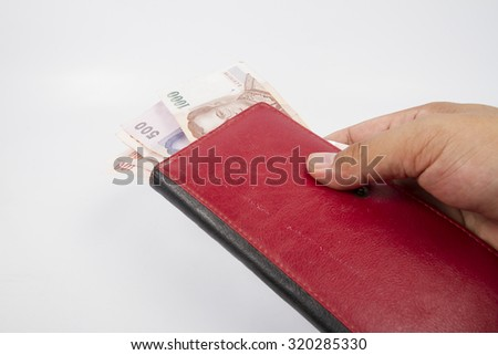 red purse  in the hands on a white background - stock photo