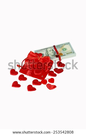 Red purse with red hearts and one hundred dollar banknotes - stock photo