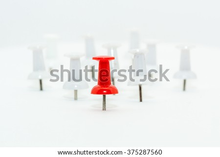 Red Push pin in front and white push pins at back. Leadership concept - stock photo