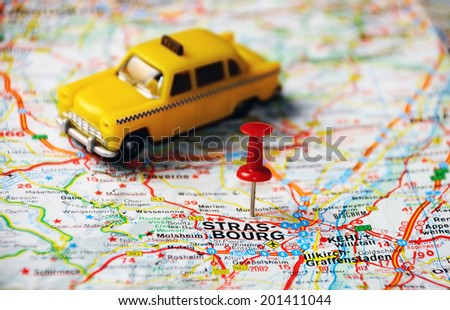 Red push pin pointing at Strasbourg , Belgium map   and a taxi - stock photo