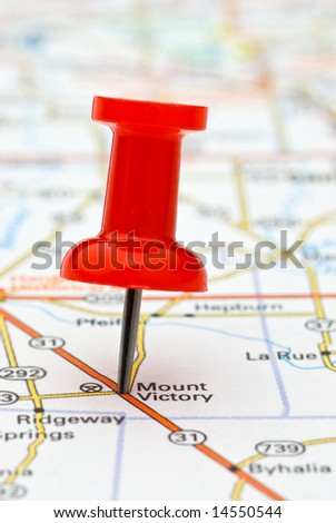 Red pushpin marking a location on a road map, Mount Victory, selective focus - stock photo