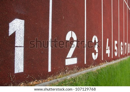 red race track with numbers - stock photo