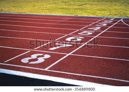 Red race track with numbers. - stock photo