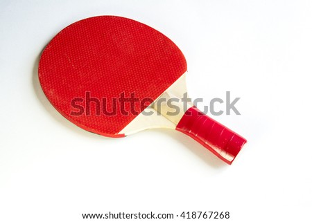 Red racket for ping- pong table