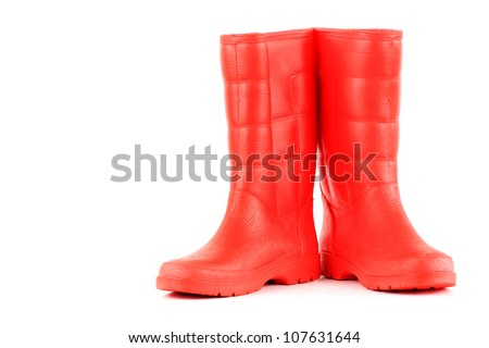 red rainboots isolated on white background - stock photo