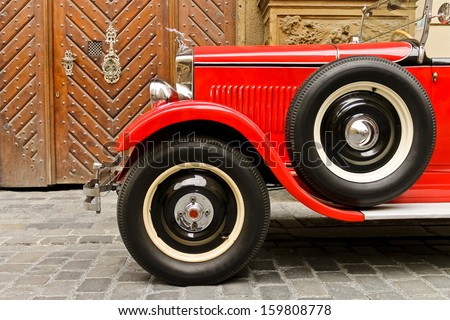 Red rarity vintage car - stock photo