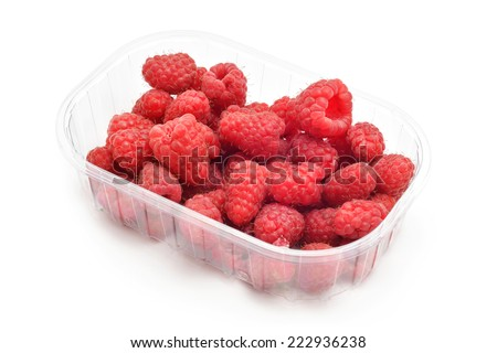 red raspberries case on white - stock photo