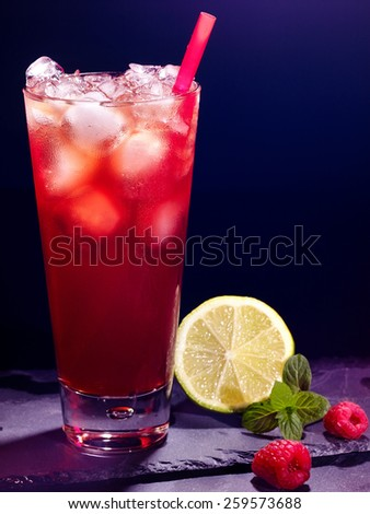 Red raspberry drink  with green lime on black background. Cocktail card 8. - stock photo