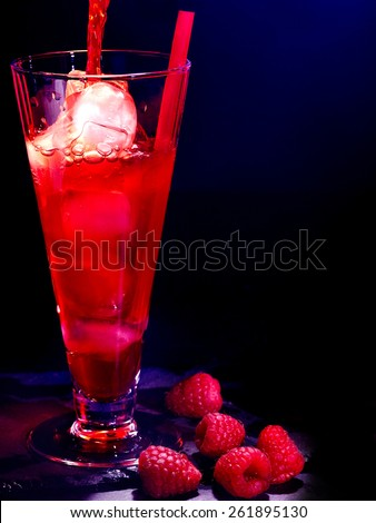 Red raspberry drink  with ice cube on black background. Cocktail card 12. - stock photo
