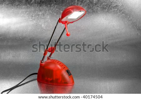 Red reading lamp on silver background