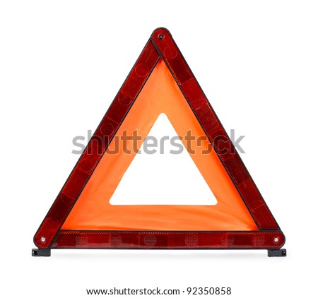 Red reflecting traffic warning triangle isolated on white - stock photo