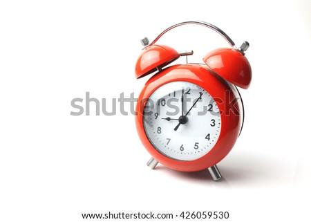 red retro alarm clock on white background - stock photo