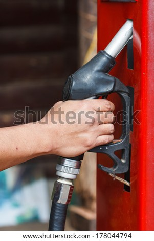 red retro gasoline pump in the old gasoline station - stock photo
