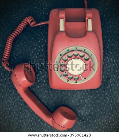 red retro phone from above - stock photo