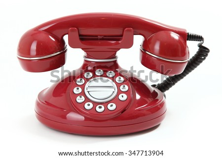 red retro-styled telephone on white background