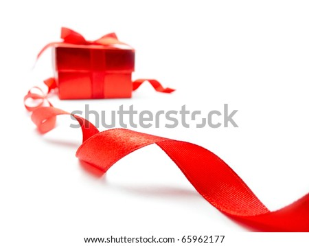 Red ribbon and red gift box on white background - stock photo