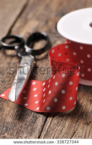 Red ribbon and scissors  - stock photo