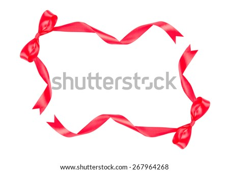 Red ribbon bow on white background with copy space - stock photo