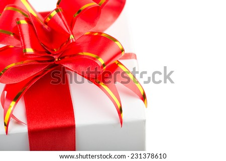 Red  Ribbon Bow on white gift - stock photo