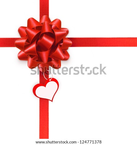 Red ribbon bow with blank heart label on white background - stock photo