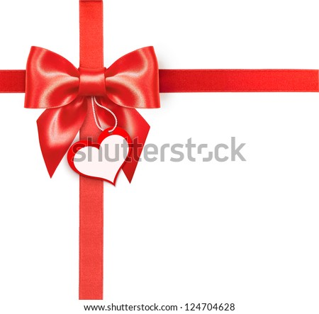 Red ribbon bow with blank label - stock photo