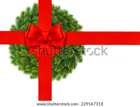 red ribbon bow with christmas wreath isolated on white background - stock photo
