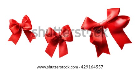 Red ribbon bows on a white background