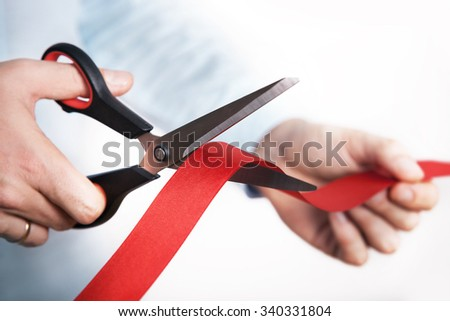 Red ribbon cutting for open new project - stock photo