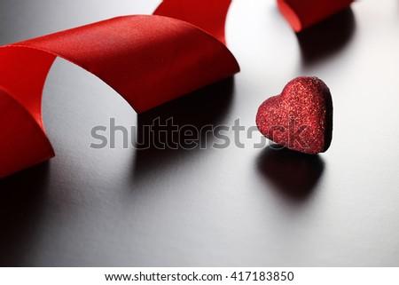 red ribbon heart - stock photo