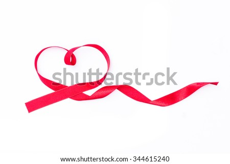 Red ribbon in heart shape on white background symbolic concept for raising awareness and support people living with HIV on world aids day: Universal sign for love, supporting and help person with AIDS - stock photo